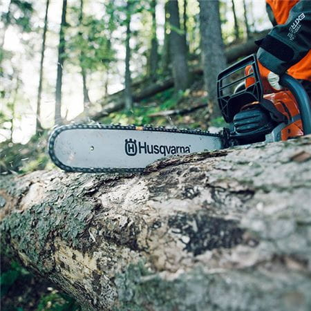 Husqvarna chainsaw cross cutting fallen tree