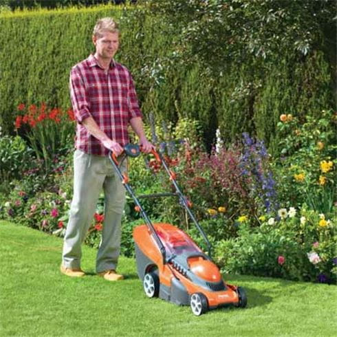 Cutting the grass with a rotary mower