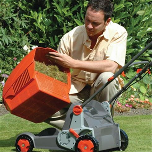 autumn lawn care blog, lawnmower outside