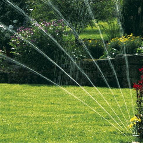 Watering the lawn with a sprinkler