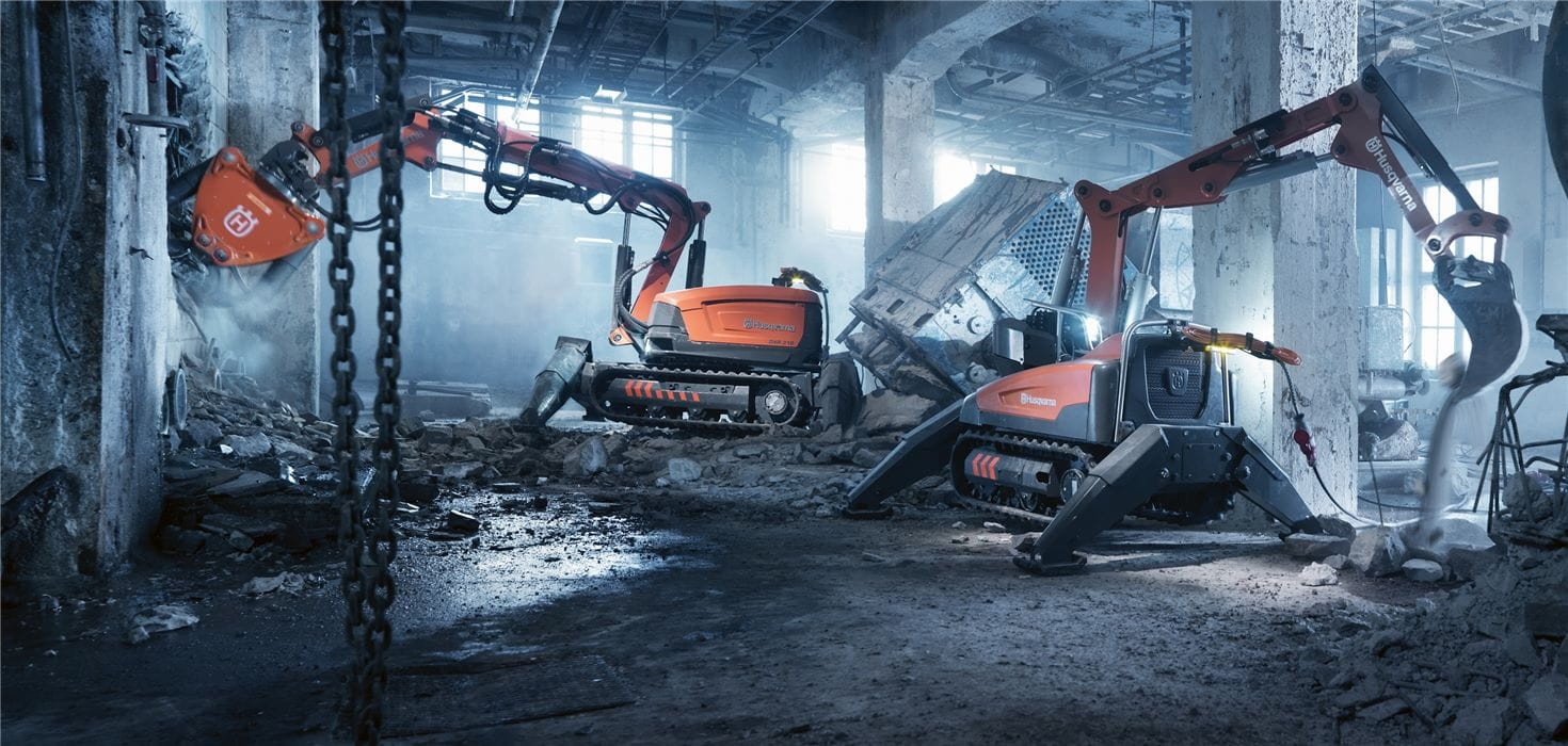 Remote demolition robots dismantle concrete structures indoors: Husqvarna DXR 310 and DXR 140