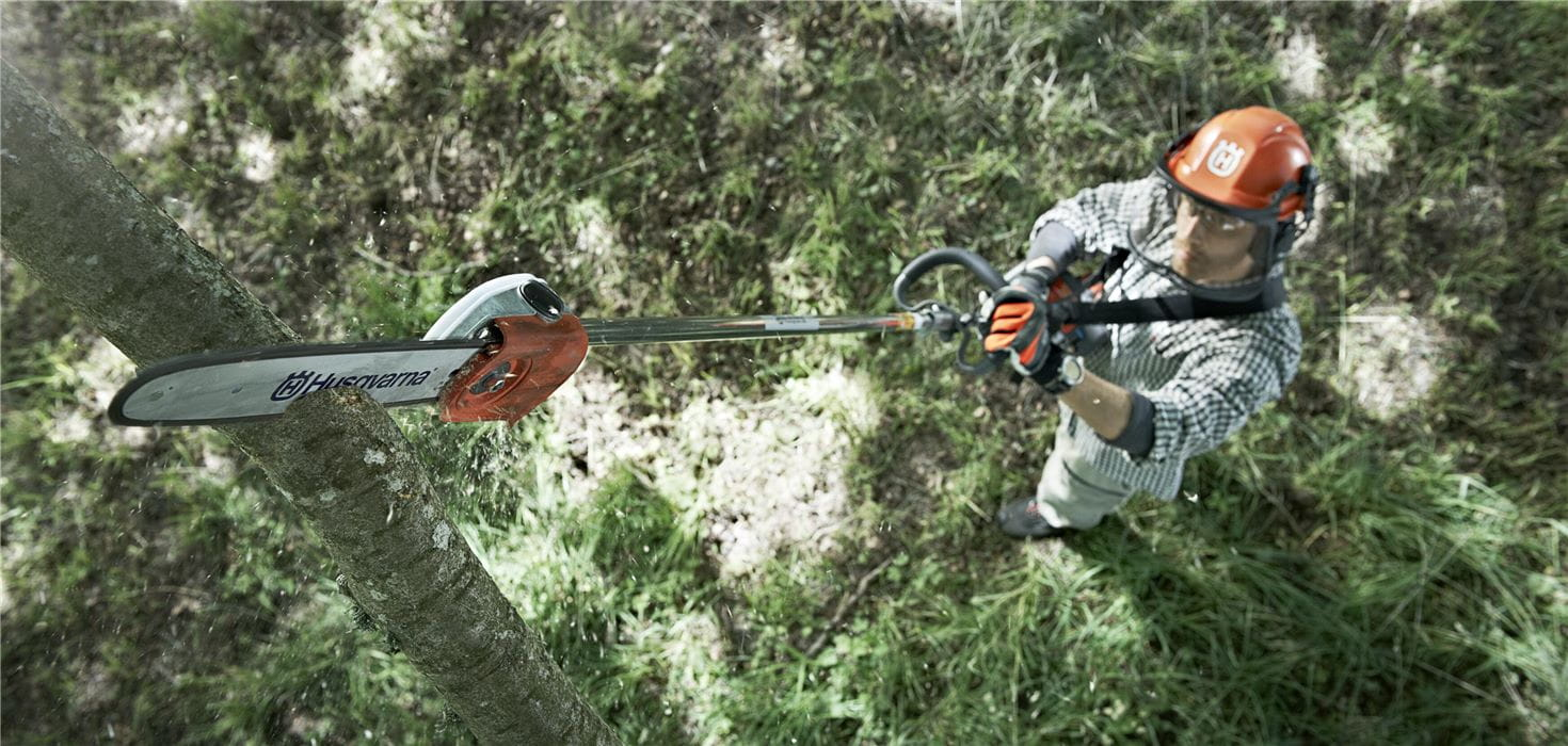 Man sawing high branch with Husqvarna Pole Saw