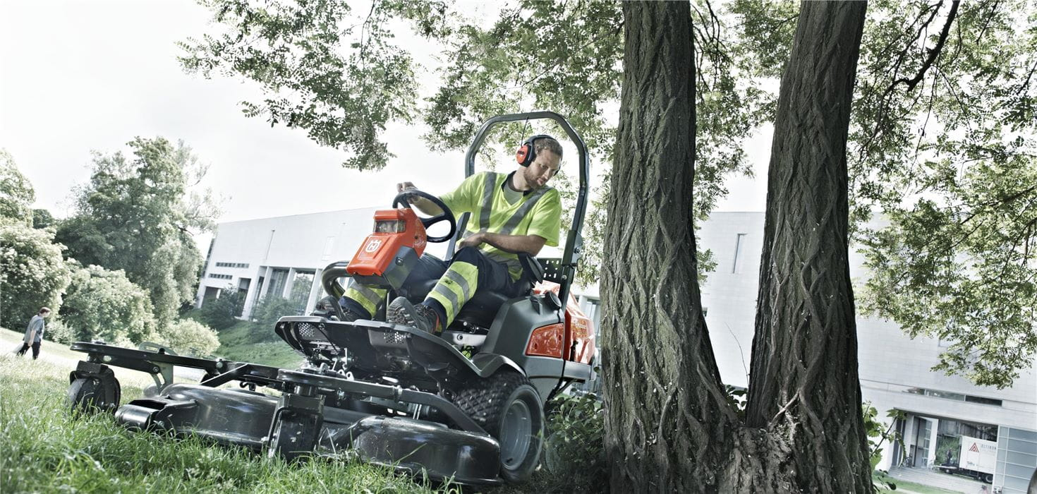 Man on a Husqvarna Front Mower in a park