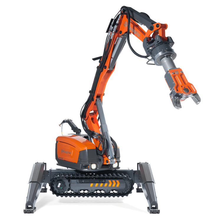 Remote demolition robot Husqvarna DXR 140 equipped with rotating steel shearer for high-precision cutting of metal structures.
