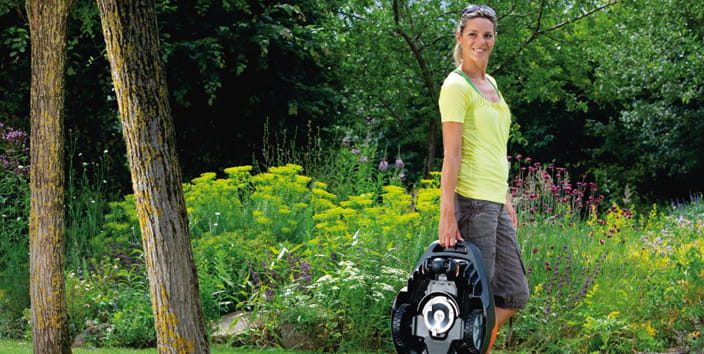 woman carrying robotic mower