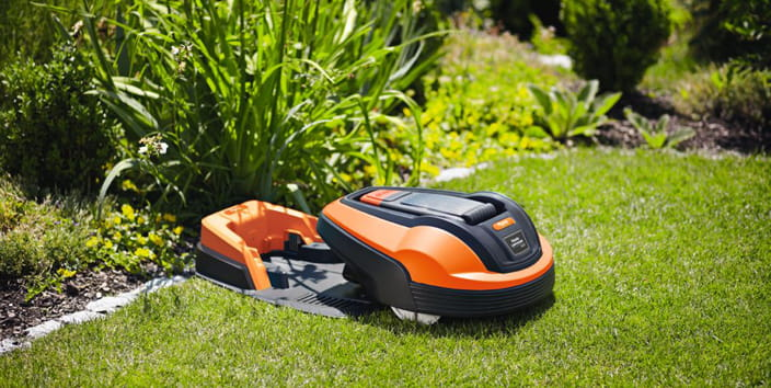 summer lawn care blog, robotic lawnmower charging station
