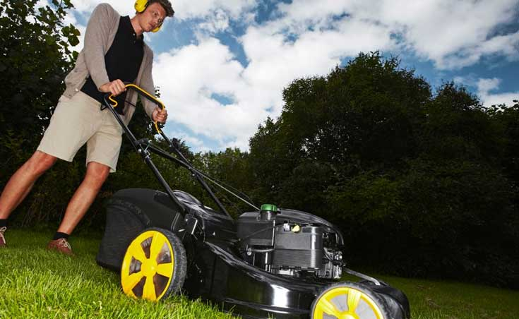 Cutting the grass using a McCulloch lawnmower